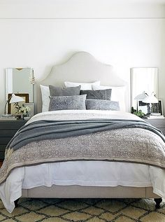 Mix designs with intricate motifs and woven flourishes, such as slate-blue throw pillows with fringes, charcoal-gray knit blankets, and stone-hued batik or block-printed shams. En masse, these elaborate details bring depth and instant coziness to a space.