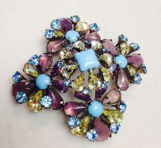 What an exciting vintage find! This signed Schreiner New York brooch is in the most heavenly color combination of soft purple, turquoise, blue and yellow. This large brooch measures 2.5 inches, and domes up in profile, making it appear even larger. The design is 5 flower clusters, and the metal is silver tone. What a fabulous brooch for the upcoming Spring season