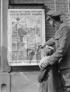 WWI. Belgian after the liberation; poster issued by the Belgian Government warning of the 'Danger des Engins explosifs' by Van Sassenprouck. Near the Belgo-German frontier, 25 March 1919. ©IWM
