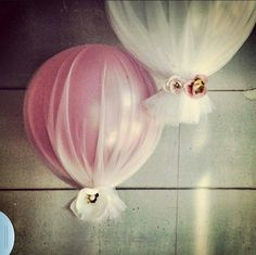 Generally I hate balloons at weddings, but here is a new twist.  Wrap them in tulle (in your wedding colors) and they are suddenly a lot more elegant!  That's a paradigm shift!