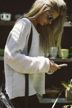 The perfect sweater to stare at your iPhone all day in