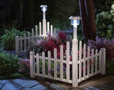 White Fence Corner Lawn Edging With Solar Light.  http://www.northerntradingco.com/product/white-fence-corner-lawn-edging-with-solar-light