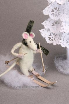 Miniature mouse tests out a set of skis made from recycled wood and paper. - Photo © 2011 Lesley Shepherd