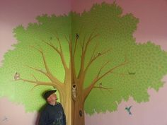 We painted this woodland animal tree in a little girls bedroom. The walls were already painted a pretty pale pink, so we painted the mural over the top. The tree was 12ft high and housed lots of woodland creatures, including a squirrel, hedgehog, owl and various birds. Dotted around the room we also painted some butterflies, dragonflies and another cheeky squirrel, to tie in the rest of the room. This mural took us three days to complete.