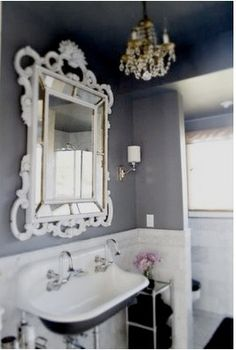 again gray that i love...can't do the mirror or light fixture probably, but I'll work in some feminine details somewhere :) already have white chair rail/wainscoating.