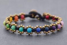 This is hand woven bracelet made with black waxed cord weaved together with malti-color stone and brass beads . Closure using brass bell ♥ Bracelets Diy Schmuck, Schmuck Design, Macrame Bracelets, Jewelry Bracelets, Bracelet Making, Jewelry Making, Jewelry Crafts, Handmade Jewelry, Jewelry Accessories