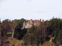 "Alexander Graham Bell's Mansion, Beinn Bhreagh; From The ""Amoeba"" As We Sail The Bras D'or Lakes at Baddeck, Nova Scotia with Amoeba Sailing Tours."