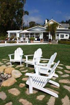 To maximize space, the Mecay family extended their living area to the outdoors. The home is surrounded by decks and seating areas such as this outdoor living room, designed with the same natural elements as the rest of the home. The outdoor space is fully equipped with an entertainment center, fireplace and beverage cart.    Outdoor furniture, plants and accessories: Botanik