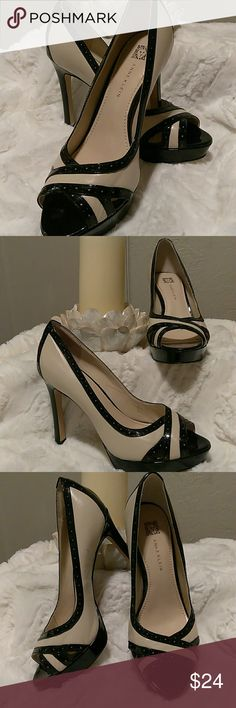 Anne Klein leather pumps. New size 7 Black Patent and cream leather peep toe platform pumps. Beautiful 💕 and ready for work or a night out in the town. Never worn. New but no tags. Anne Klein Shoes Heels