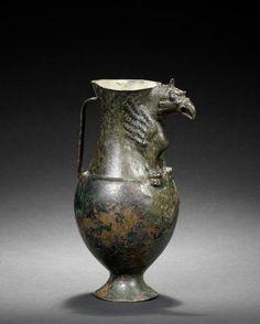 A Parthian bronze vessel with griffin spout. Circa 1st Century B.C. - 2nd Century A.D.
