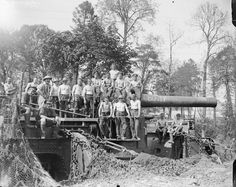 Stripped gunners of the Royal Garrison Artillery loading a 12-inch gun (named Bunty) at Louez, 19 May 1918.