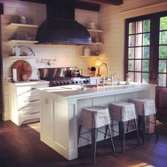no to the stools, and I don't know where the refrigerator is, but it still looks lovely