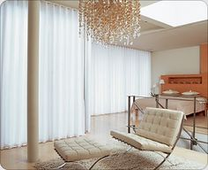 sheer curtains and chandelier