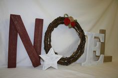 Christmas decor Noel letters Noel wood letters Christmas mantel primitive wreath rustic Christmas decor. $39.95, via Etsy.
