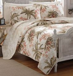 Turn your bedroom into a laid-back island getaway with the Tommy Bahama Bonny Cove quilt.  A tropical floral motif is printed on rich, warm ivory to give your room a casual, beach charm.  Twin size quilt measures 88 x 68 inches.