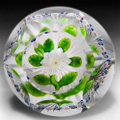 Antique Baccarat Clematis and millefiori garland faceted glass paperweight. by  Baccarat Antique