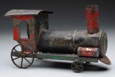 Lot # : 672 - Early American Tin Train Engine Floor Type.
