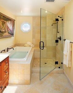 Using width of bath as a divider.  Small seating incorporated.  Like the idea of the door.