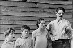 This picture show a family activity which is sunday sings where by parents interect with their kids having some family time. This shows the family love when the dad tries to teach his kids singing by going first   - Sunday Singing photograph by Walker Evans