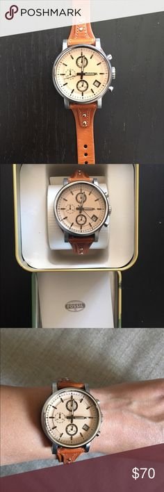 Women's Boyfriend Style Fossil Watch Leather.  Excellent condition, only worn twice.  No scratches or stains.  Leather band in excellent condition as well.  Comes with the box.  If you have any questions, feel free to ask! Fossil Accessories Watches