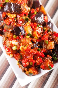 Sauteed Eggplant Peppers and Tomatoes - olive oil, eggplant, salt & pepper, onion, red bell peppers, tomatoes, garlic cloves, paprika, turmeric, tomato sauce, water, green onions, fresh parsley, fresh cilantro
