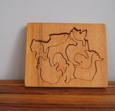 One of a kind, charming handmade wooden puzzle. Ten animal-shaped pieces cut from 3/4 thick wood on plywood backing. Horse, bear, rabbit, duck, shark,