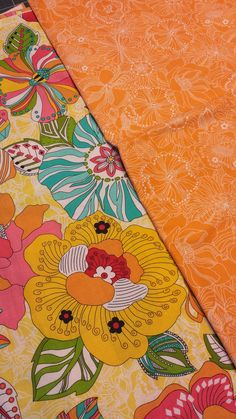 Light yellow w/ giant colorful flowers! w/ orange florals