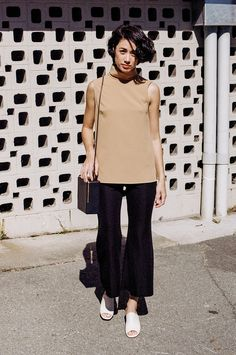 Stack Top from Jesse Kamm is a sleeveless turtleneck that has a powerful sense of elegance and ease. Cut in a Japanese Rayon Crepe that creates a b...