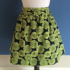 Lt. Green & Black Printed Skirt Get ready to have some fun with this cute skirt.  The skirt is very comfortable and has pockets. .  There is a front tie so that you can make it as tight or loose as you want.  The skirt is also lined, so you can't see through it.  Material: 100% Cotton Merona Skirts