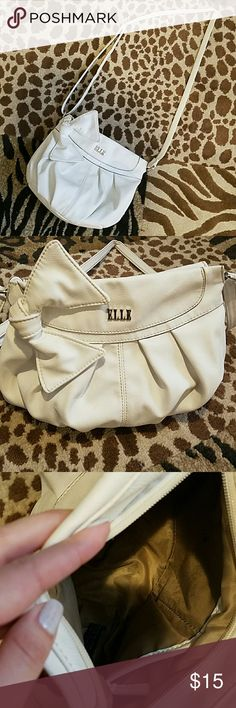 "Elle Purse *Crossbody, 10"" wide x 8.5"" tall *Strap is adjustable up to 24"" *Color:White *Used, little signs of wear, some pen marks inside, no rips or holes *3 pockets inside, 1 zip pocket on the back.  Make me an offer :) Elle Bags Crossbody Bags"