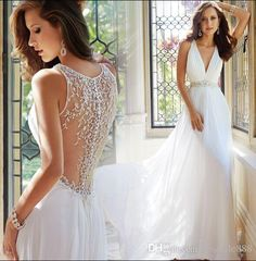 Buy wholesale  wholesale new arrival hot sale fashion specials princess luxurious gown backless deep v collar empire beaded small tail custom wedding dress which is at a discount now. bestsale888 has guaranteed its quality. white wedding dress, amazing wedding dresses and backless wedding dress are all in the list of superb dresses.