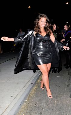 Ashley Graham is all smiles in New York as she navigates her way off a curb when departing Harry Josh's Met Gala pre-party.