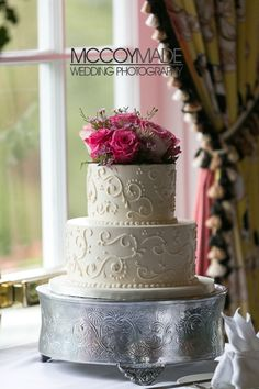 Wedding cake with pink flowers, made by Grand Hotel on Mackinac Island. -image by McCoyMade 2014- #MackinacIslandWedding #GrandHotelWeddingPhotography #McCoyMadePhotography #NorthernMichiganWedding #PureMichganWedding