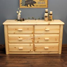 The Northwoods 6 Drawer Log Dresser may be finished in the standard catalyzed lacquer or in a honey pine finish. Description from logfurnitureplace.com. I searched for this on bing.com/images