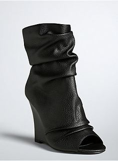 Go ahead, sneak a peek peep! Scrunched up black faux leather covers these sky-high wedge booties, lending volume to the pedicure-baring peep toe. wedge Man-made materials Imported Black Peep Toe Boots, Lace Up Wedge Boots, Lace Up Wedges, Black Booties, Ankle Booties, High Wedges, Peep Toe Wedges, Wedge Heels, Shoe Dazzle