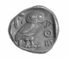 An owl and olive twig, symbols of the goddess Athena, on the reverse of an ancient Greek tetradrachm (coin / unit of currency) of Athens. (Museum of Fine Arts)