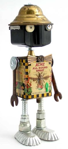 """""""Garden Gnome""""   Height: 13""""   Principal Components: Garden insecticide tin, Baby Brownie camera, lamp part, wrenches, hose fittings, tartlet tins, clock gear, buttons"""