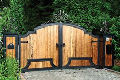 Architecture, Driveway Gate With Metal Design Black Color Iron Double Swing Door Bricks Posts Pretty Garden Unique with Front Gate Design, Main Gate Design, House Gate Design, Iron Gates Driveway, Driveway Entrance, Wooden Gate Designs, Wooden Gates, Side Gates, Entry Gates