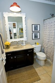 Yellow & gray bathroom... Possibly master bath (love the pop of color with the orange light)