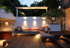 Contemporary Interior Courtyard decked garden built in wooden bench