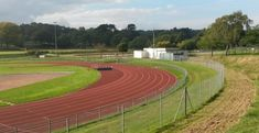 Artificial Grass Pitches Infield Running Tracks in Great Baddow. Artificial Grass Pitches Infield Running Tracks in Great Baddow Glasgow City, Running Track, Track And Field, House In The Woods, Pitch, Grass, Park, Somerset, Holy Cross