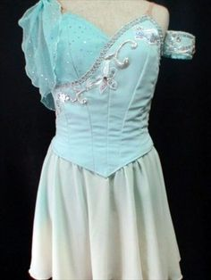 An exclusive creation to be used for Talisman, Diana and Actaeon or Cupid. This hand sewn and embroidered stage costume features a delightful shade of pale blue, and silver decorations. The bodice is
