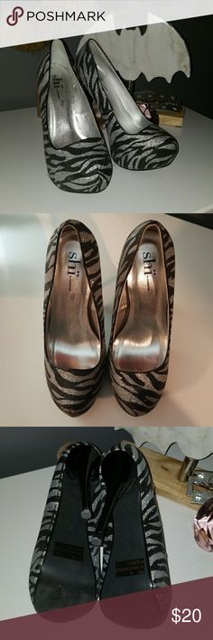 Shi by Journeys Zebra Pump Size 6 Comfortable and barely worn pumps. Minimal wear on spike of heel and sole of shoe from two nights on the town! Shi by JOURNEYS Shoes Heels