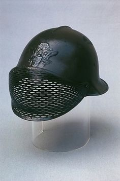 A Franco-American Dunand helmet with protective visor, designed by the Swiss metalsmith Jean Dunand in 1917, for use towards the end of the First World War. Seen here on display, probably in a museum. Though highly thought of, it did not go into mass production. Pin by Paolo Marzioli