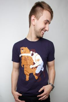 Many have speculated as to what the Haymaker T-shirt means.  Is it Chuck Norris or Paul Bunyon knocking out a bear on a shirt?  Or might it represent the Cold War since the bear has Russian on it and the guy on the tee looks American?  Maybe it's a t-shirt with an image of your dad or boyf...