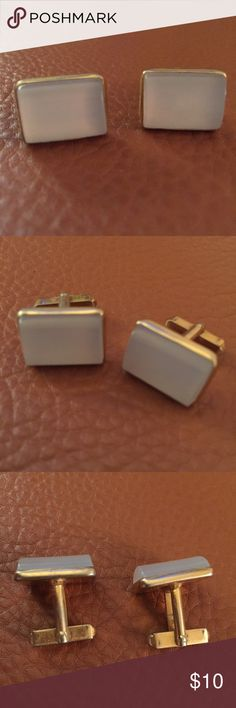 Ivory and gold tone cuff links Complete your (man's) look with a pair of rectangular cufflinks with a curved mother of pearl tone front accent. They are silver tone and are mounted on a swivel fitting. These stylish cufflinks are designed to complement a range of formal shirts. For the well-dressed man. Accessories Cuff Links