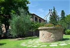 The exterior of the Canale Farm located in the Tuscan hills.