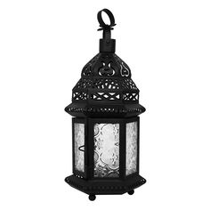 """This small lantern is only about a hand high. A good size for a votive candle (not included). Two panel door has a 2 3/4"""" x 3 1/4"""" opening. 10 1/4"""" high with hoop up. Matte Black Finish. Brand Name: Pergratus."""