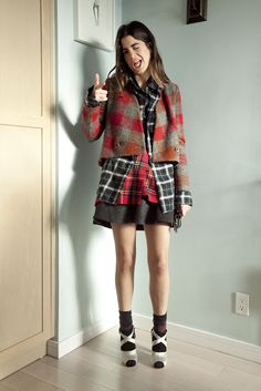 Layering plaid compliments of the Man Repeller