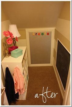 Black board and magnetic board under the stairs. I love the look of it. Could have small toy storage too